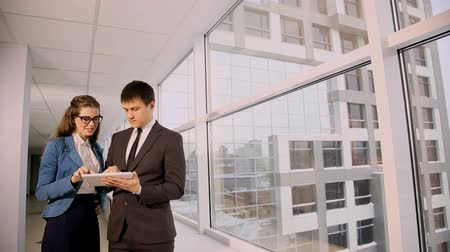 man and woman in the office building of the discussion Stock Footage