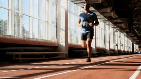 young athlete running in the hall to warm up Stock Footage