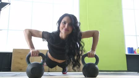 girl in a gym performing sports exercises Stock Footage