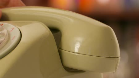 telephone handset : A man pick up phone call. Old phone set in closeup