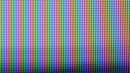 television set : TV or computer screen closeup with the electroluminescent points changing in broadcasting