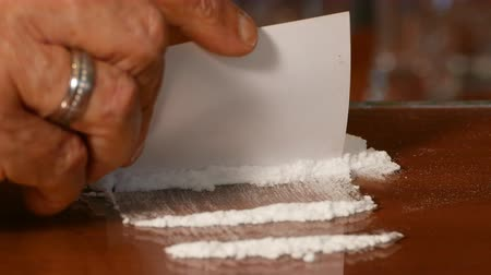 methamphetamine : Splitting Cocaine On The Table, Illegal Drugs Stock Footage