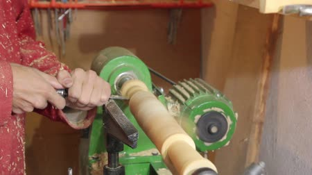 treadle : Foot operated spring pole wood lathe.  Man operating a foot operated spring pole wood lathe. Stock Footage
