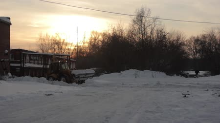 wayside : tractor cleans snow