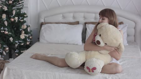 coquettish : beautiful girl with toy on bed