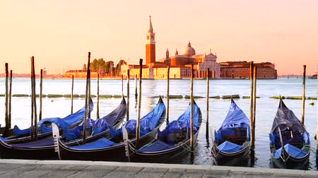 veneza : Gondolas moored by Saint Marc square with San Giorgio di Maggiore church in the background - Venice, Venezia, Italy, Europe