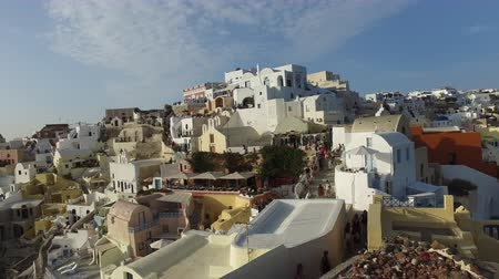 УВР : Oia (Santorini island) JMAY 29, 2016: Sunset over the Aegean Sea viewed from the beautiful town of Oia on the Island of Santorini, Greece, Europe