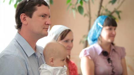 церковь : family with a baby on the baptism in the church