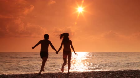 corrida : Teen couple on the beach