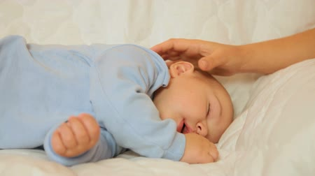 napping : Mothers hand stroking the sleeping baby Stock Footage