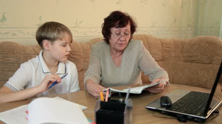 schoolbook : Grandma helping grandchild doing homework
