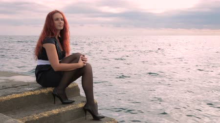 ruivo : Woman sitting near the sea Stock Footage