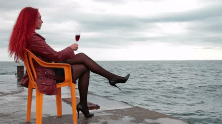 içme : Young woman enjoying a glass of wine Stok Video