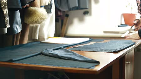 workshop : Custom Tailor Cutting a Sewing Pattern Stock Footage