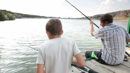 kutup : Father and son fishing Stok Video