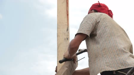 stavitel : Roofer at the construction site
