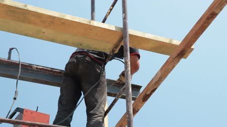 uzun boylu : Roofing works - welder working on the scaffold