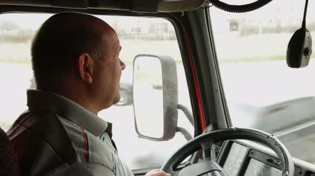 trucks : Lorry driver at the wheel of truck