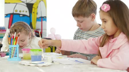 preschool : Children painting at kindergarten Stock Footage