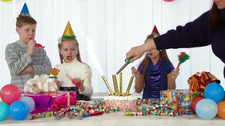 cakes : Lighting candles on the cake at kids birthday party Stock Footage