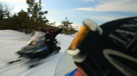 People spending winter holidays riding  snowmobile in snowy mountains Ai-Petri Crimea