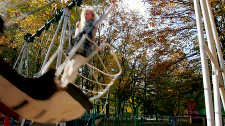 outdoor : Child riding on a swing at the playground