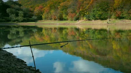 lake shore with a fishing rod in the autumn forest Krasnolesye, Crimea