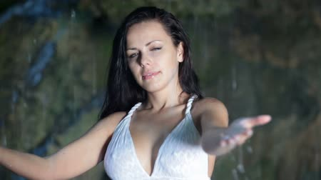 Attractive young woman refreshing under water jets of mountain waterfall in the summer woods  Great Canyon of the Crimean Mountains Silver jet Wideo