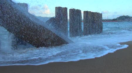 emissão : Sea is storming. big waves is on the sea. waves breaking on concrete slabs. Stock Footage