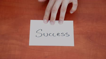 proceed : Handwritten note with the word Success