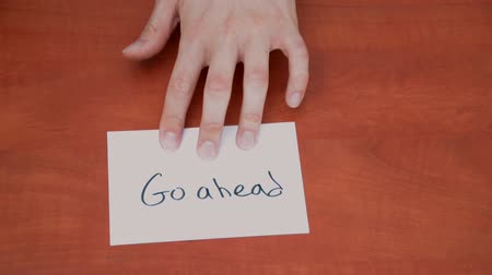 proceed : Handwritten note with the words Go Ahead