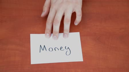richness : Handwritten note with the word Money