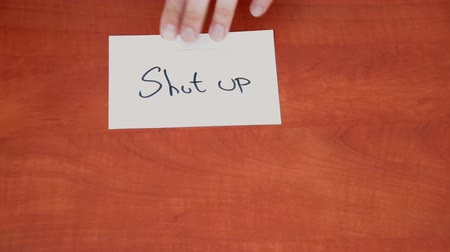 gag : Handwritten note with the words Shut Up