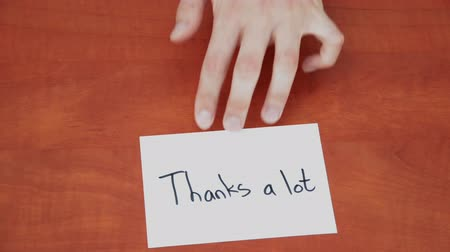 sayesinde : Handwritten note with the words Thanks a lot Stok Video