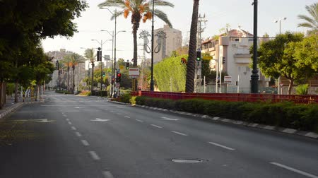 kippur : Rishon LeZion, Israel - October 4,2014: Zhabotinsky street is deserted. Once a year, on Yom Kippur (Jewish Day of Atonement) the country goes quiet as almost all cars stop running