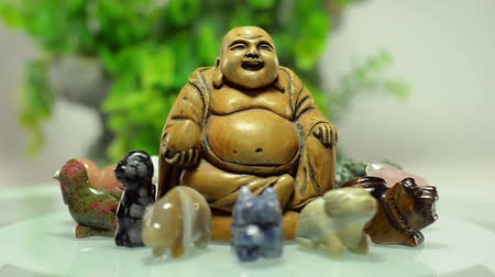 sheep pig : Buddha figurine rotates on a plate surrounded 12 Chinese zodiac stone animals