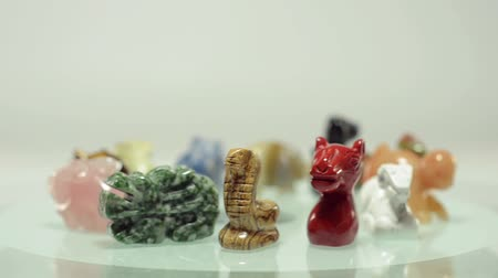 semi precious : 12 Chinese zodiac stone animals figurines rotate on a glass plate Stock Footage