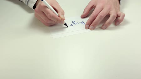 truly : Hands write the word Right on white paper sheet Stock Footage