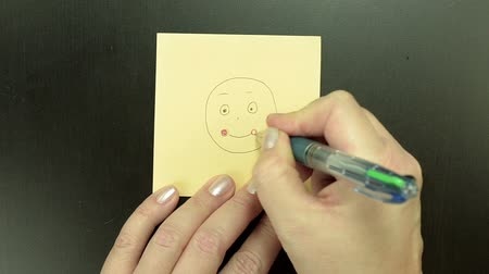 embarrassed : Drawing smiley face Blushing in boring meeting Stock Footage