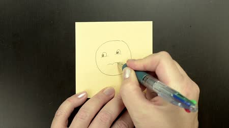 ideges : Drawing smiley face Worried in boring meeting