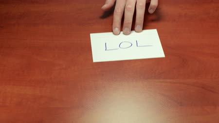 lol : LOL - short message on note paper Stock Footage