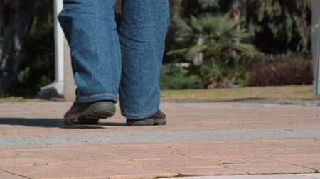 step : Man legs in brown working shoes walk away from focus to blurry Stock Footage
