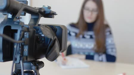 the operator prepares the camera to capture the conference Stock Footage