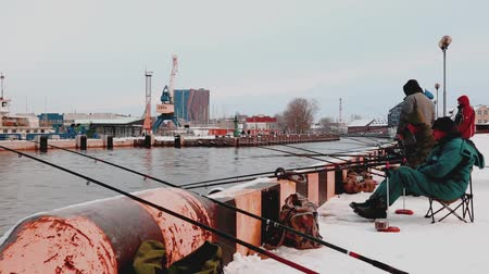 klaipeda : Ventspils, LATVIA. - 10 December 2017: People standing on mole and looking to frozen port
