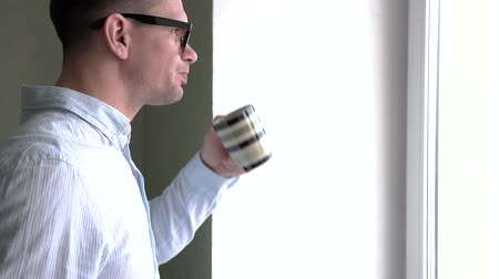 スイート : Businessman In Formal Suite Drinking Coffee 動画素材
