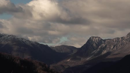 snow on grass : Timelapse - Clouds Swim Over Beautiful Mountains