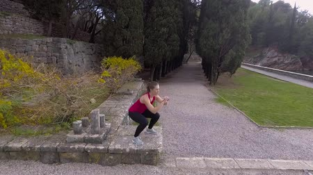 sports suit : Fit Woman Doing Cardio Exercises In The Park
