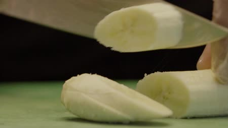 kitchen blender : Hand Of Chef In Gloves, Cut A Banana With A Knife