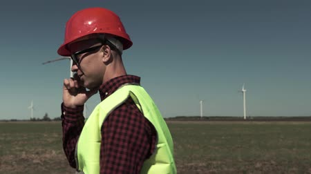 Engineer In Protection Helmet Talking On The Phone Stock Footage