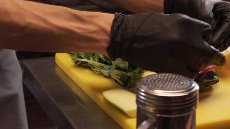 Chefs Hands In Black Gloves Fold Basil Leaves Stock Footage